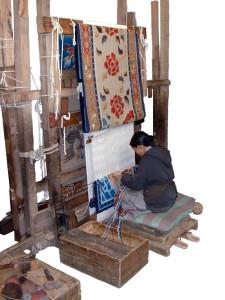 Tibetan Weaver at her loom